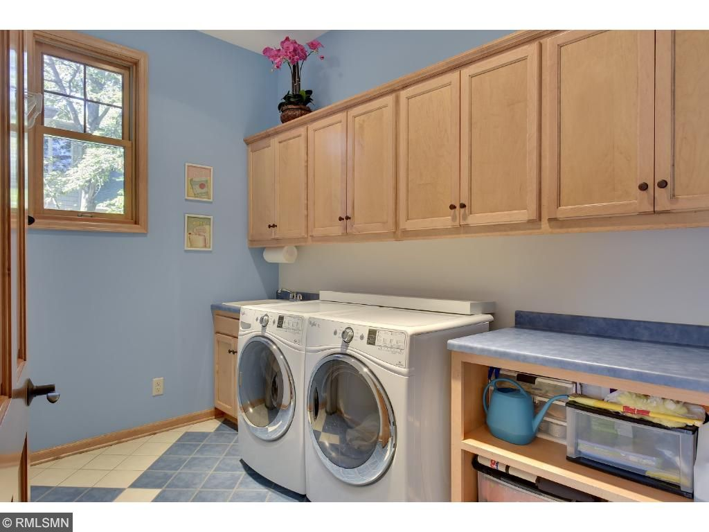 Mudroom is located on the main floor with custom cabinet lockers to hide all coats, shoes, and backpacks.