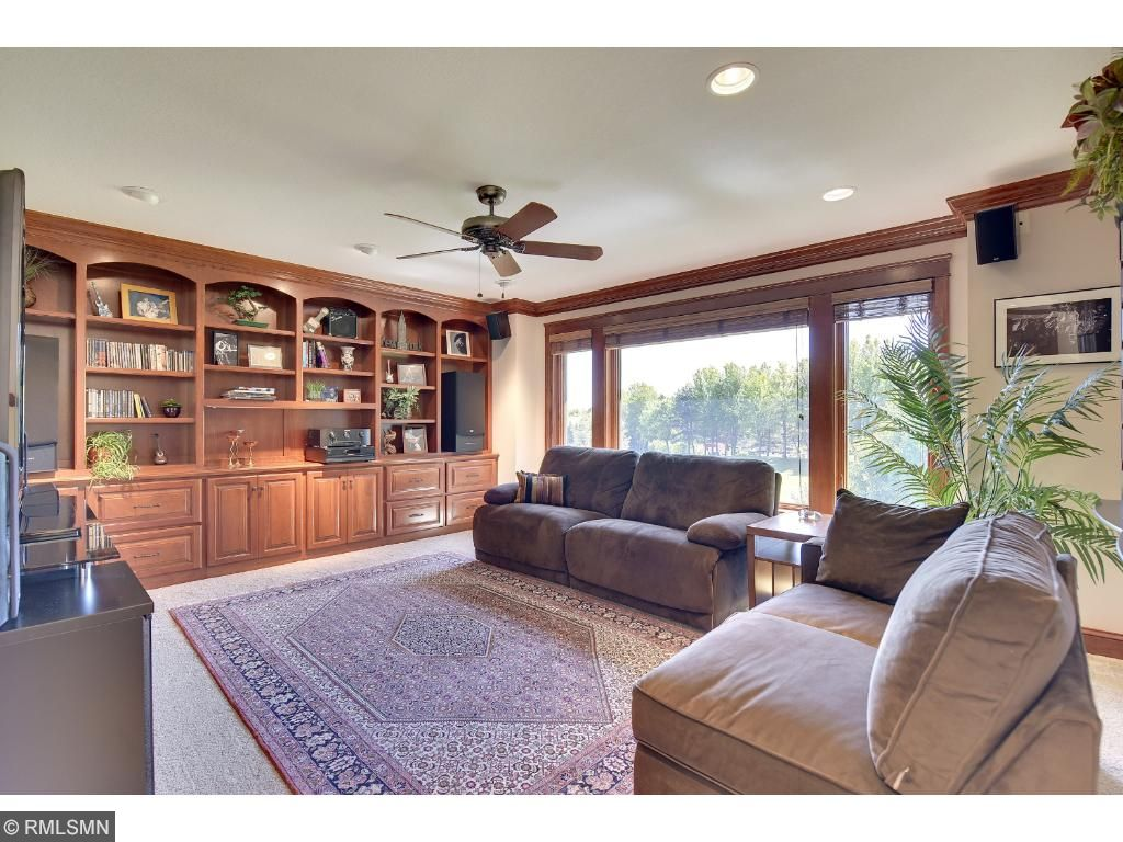 Upstairs loft has custom bookcases which is perfect for an office or library.