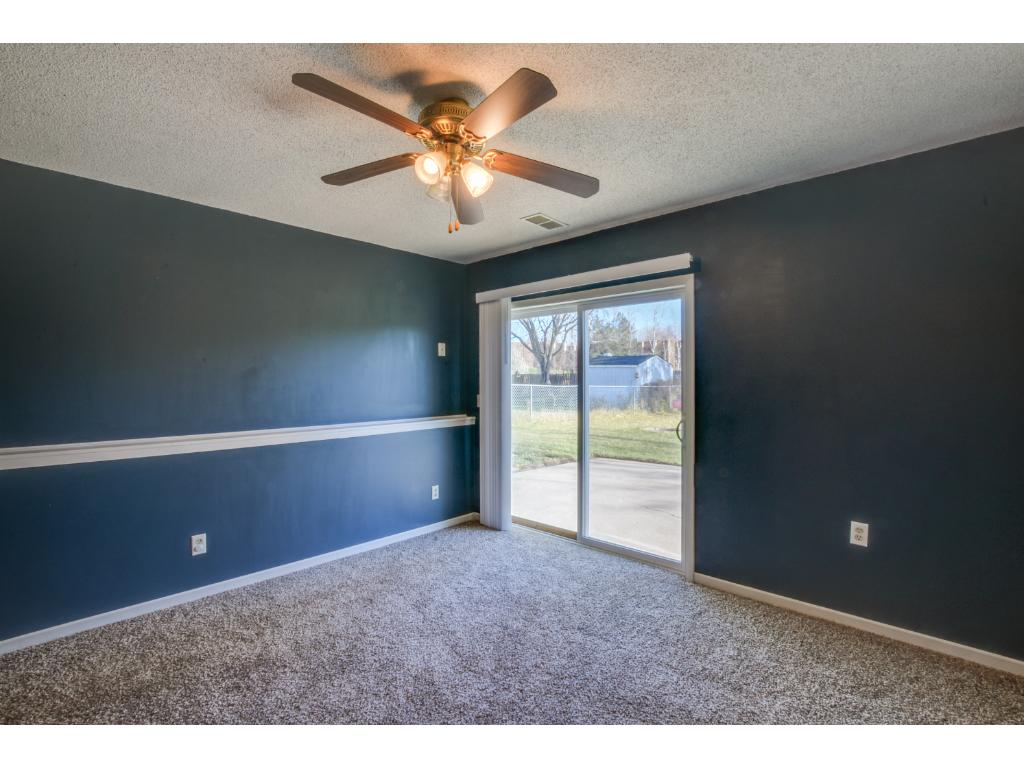 Lower level family room with new carpet & white trim! Walk-out access to the patio & backyard!