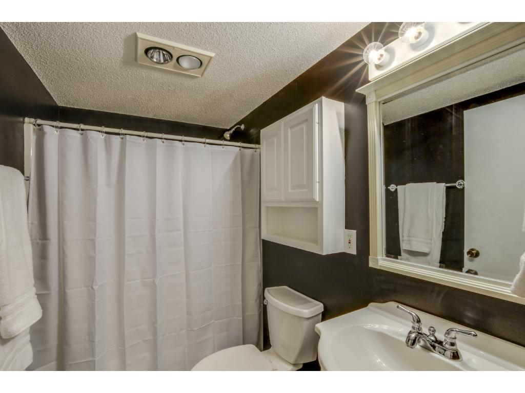 Lower level bathroom with tile flooring!