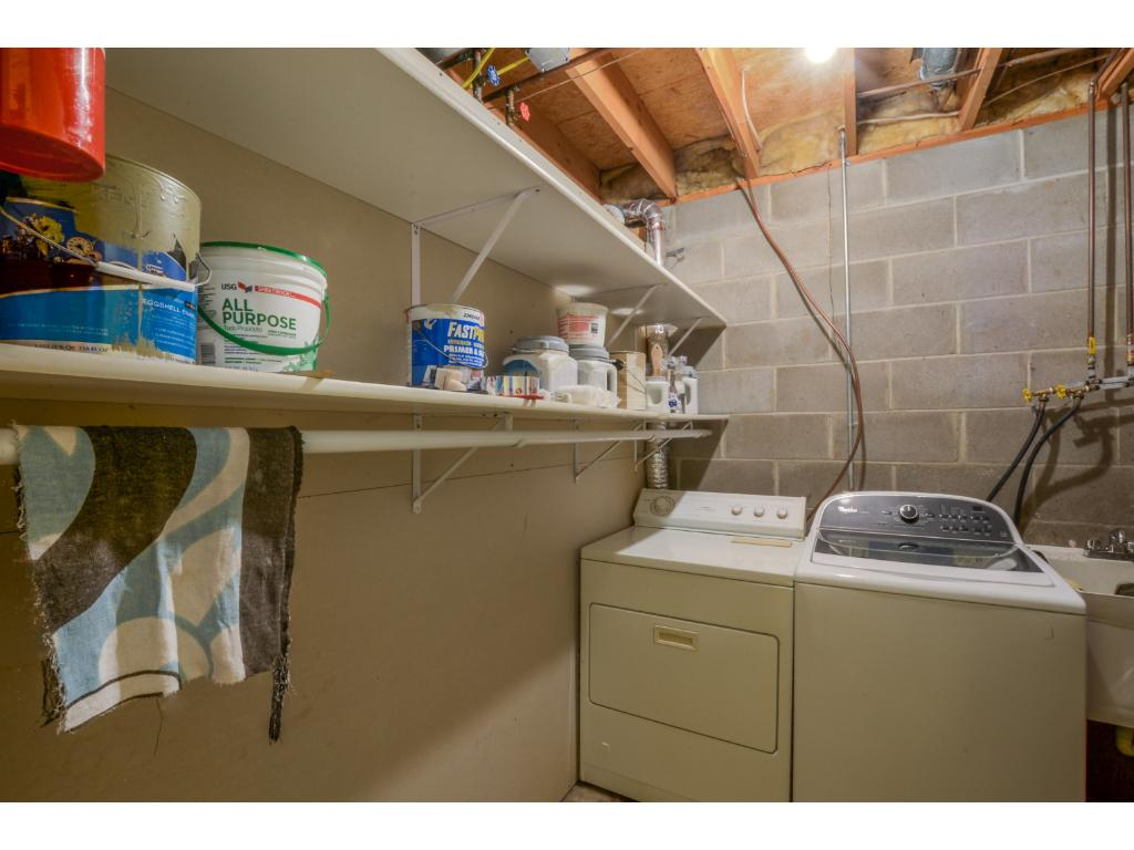 Lower level laundry w/ tankless water heater!