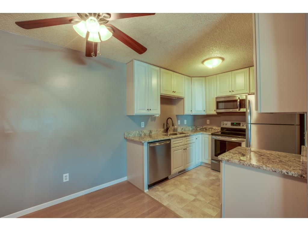Newly remodeled kitchen! Granite countertops, new cabinets, and all new stainless steel appliances!