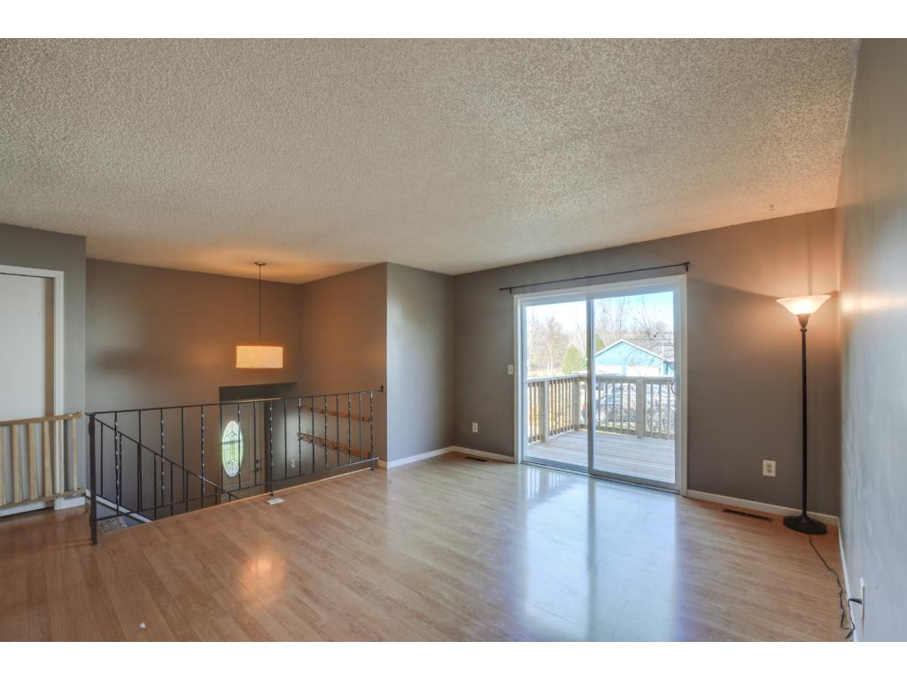 Spacious upper level living room with walk-out access to the new deck!