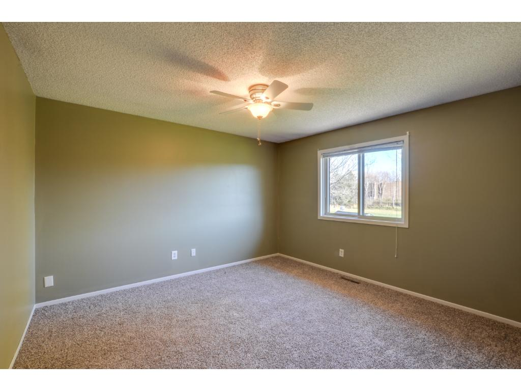 Upper level master bedroom with new carpet!