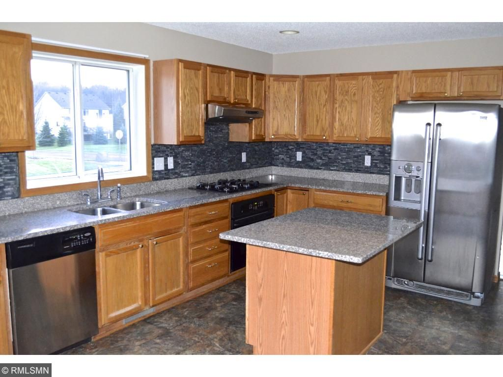 Updated kitchen with granite counter tops and stone tile.