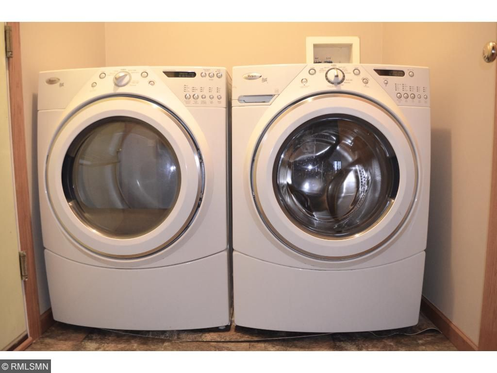 Main level laundry. Front loading washer and dryer. High efficiency