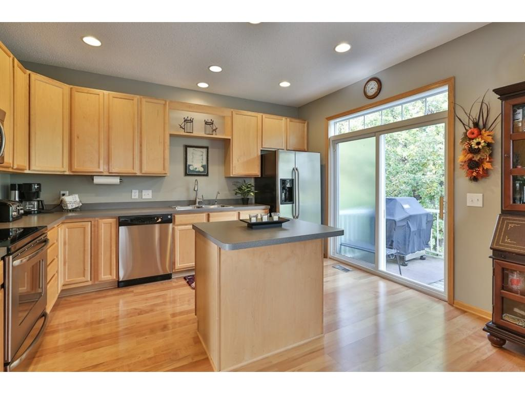 Spacious kitchen with center island and hardwood floors and patio doors leading to a Deck. Stainless steel appliances too!