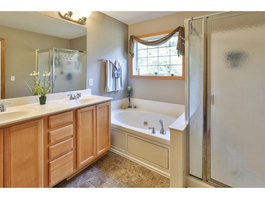 The private, Master Bath with double vanity  and separate shower.
