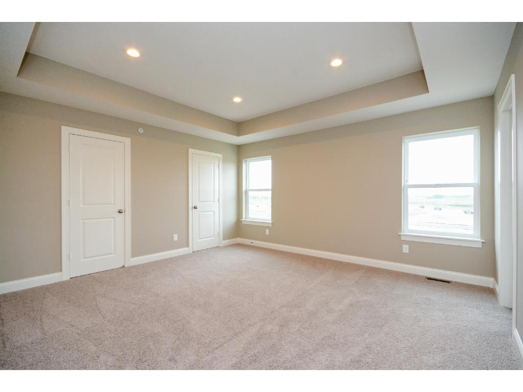 Master bedroom with coffered ceiling, recessed lights and TWO walk-in closets!