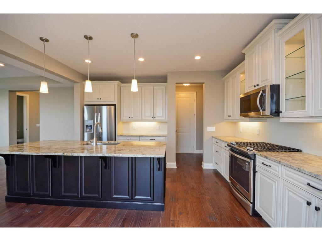 Upgraded stainless steel appliances, dove-tail construction perimeter cabinetry, recessed and pendant lighting and stylish granite countertops.