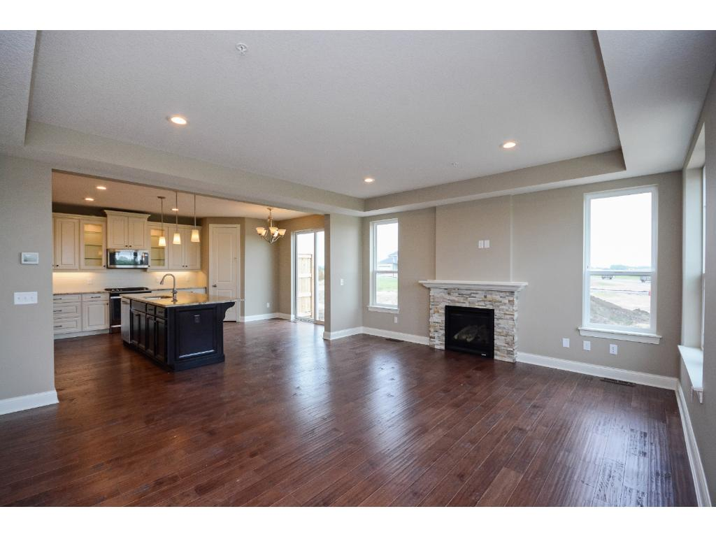 9ft ceilings on the first floor and a coffered ceiling in the family room with hardwood floors throughout!!