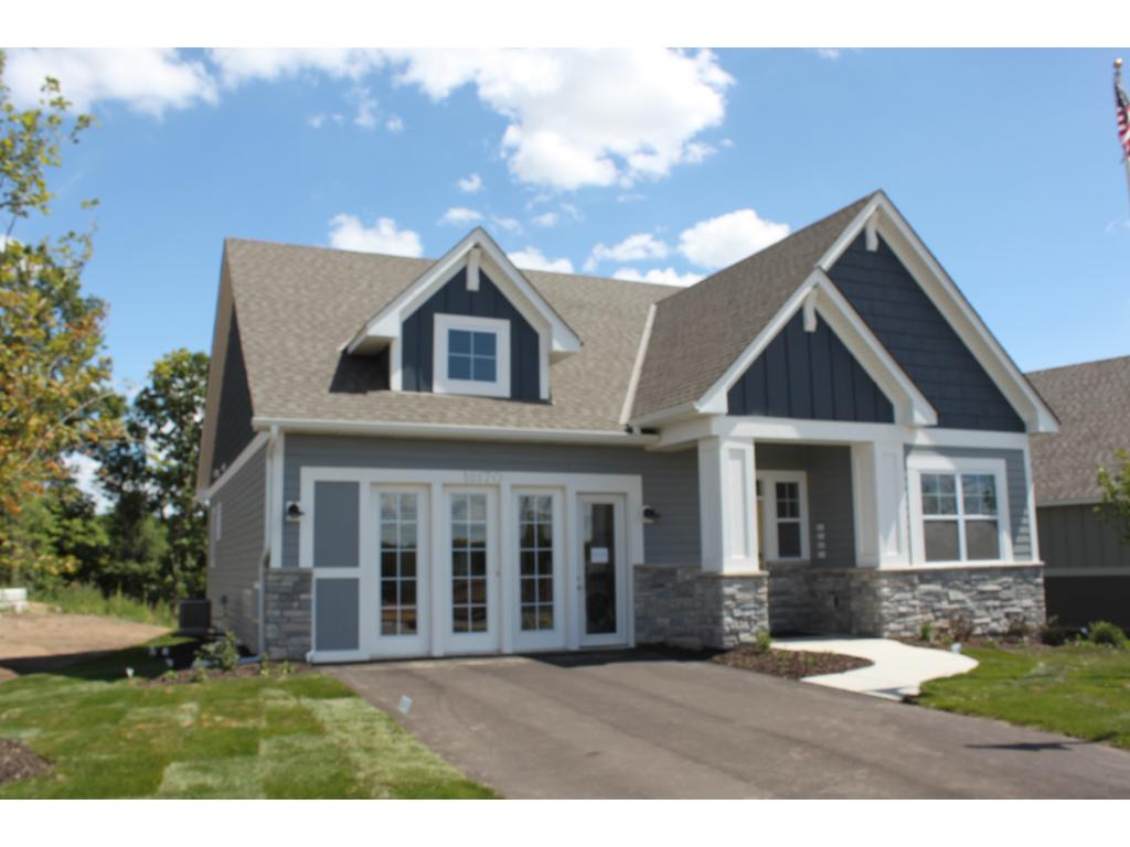 Front of Home (note garage is temporarily used as the Design Center. Garage doors with glass to be installed for Buyer.