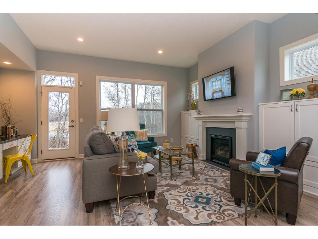 Great Room to the rear of the home captures the views to natures ponds, trees and wetland.