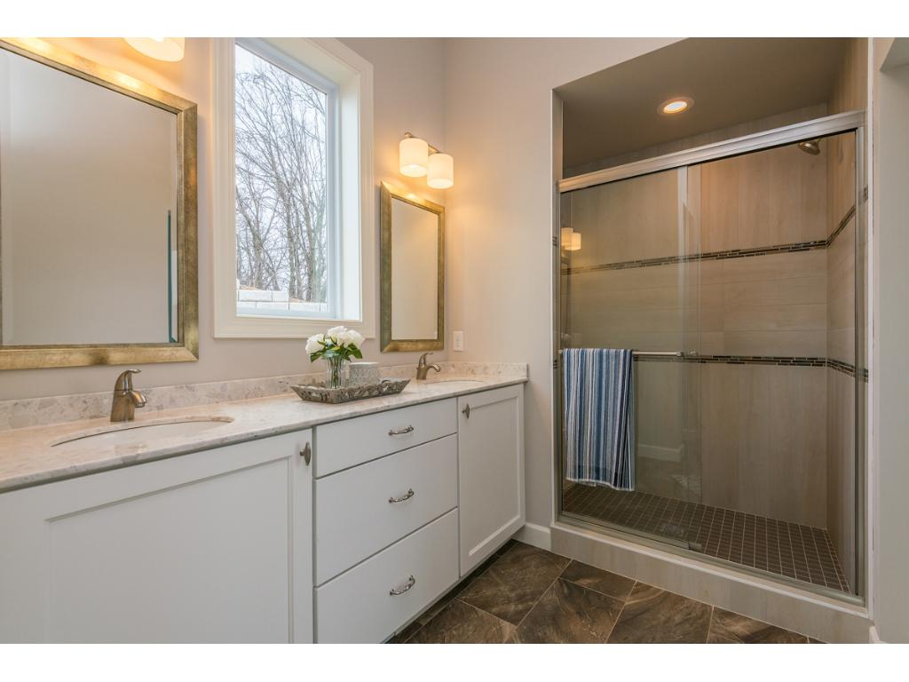 Oversized Ceramic Tile Shower in Master Bath with seat, offset controls and recessed shampoo shelves