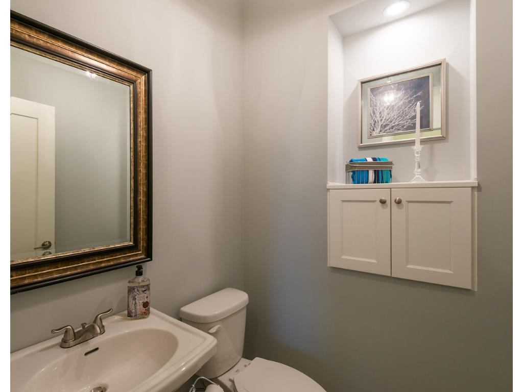 Built-in Linen Cabinet at Powder Bath for towel and paper storage