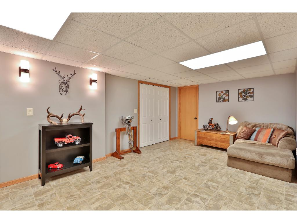 Newly finished lower level has a little sitting area to read and relax.  Full bath is located right off family room.