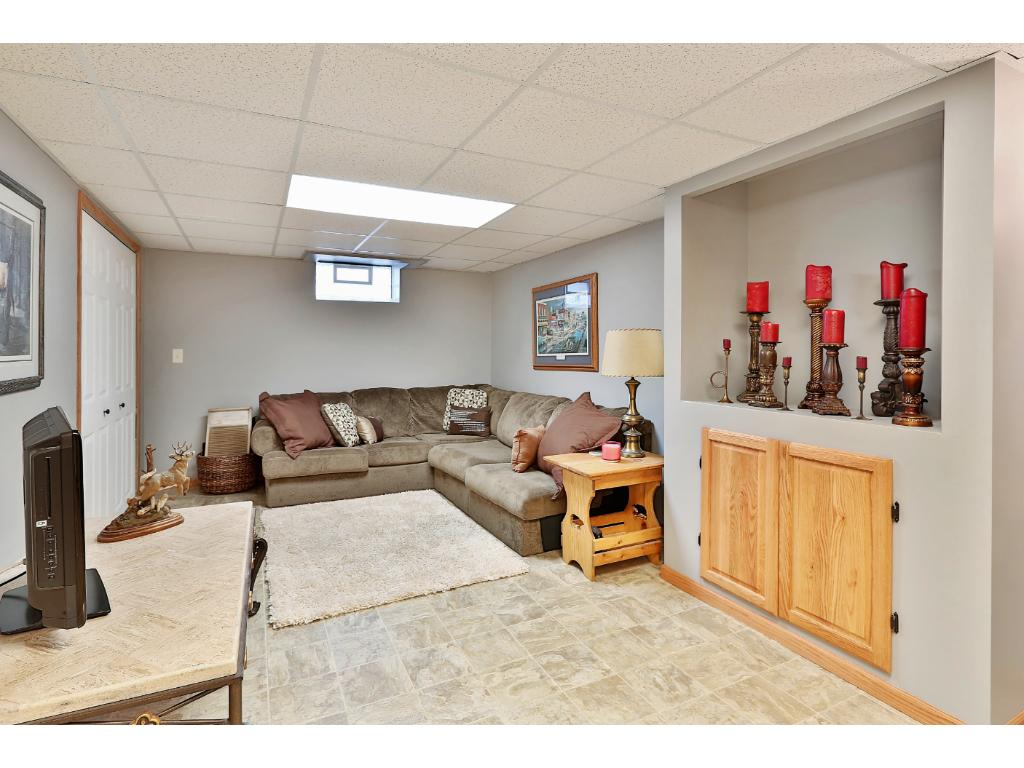 Huge lower level family room is spacious, warm and inviting.