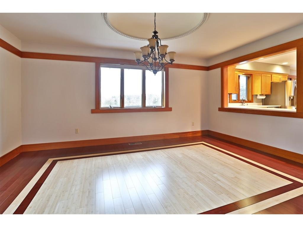 Stunning foyer has a double door entry and lots of recently added African Mahogany wood accents and trim.