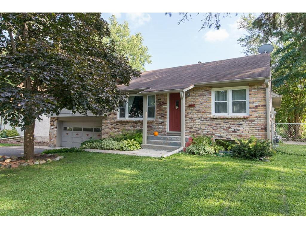 Brick front multi-level home with double garage on .44 acre lot!