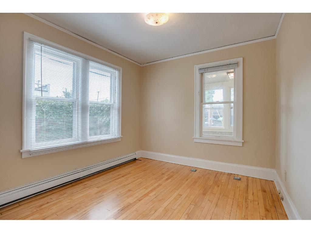 One of 2 main floor bedrooms with recently refinished hardwood floors!