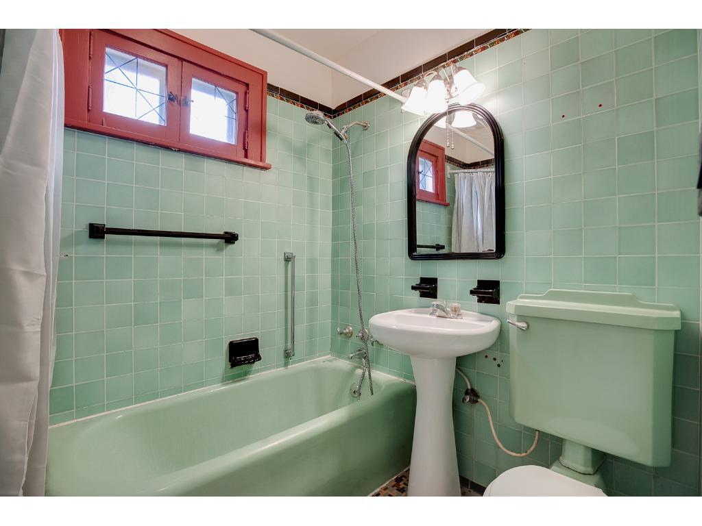 Main floor bathroom with original tilework!