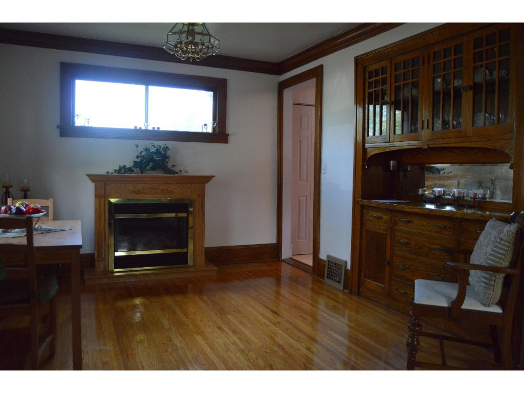 Dining room with hardwood floor, crown molding, and wood trim