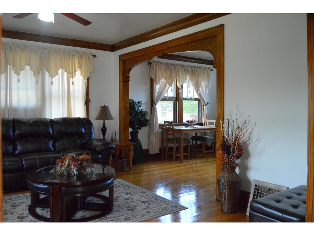 Living room from foyer showing woodwork