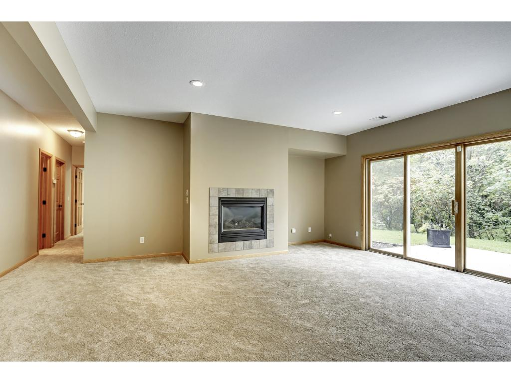 Expansive lower-level family room with sliding doors leading to the patio