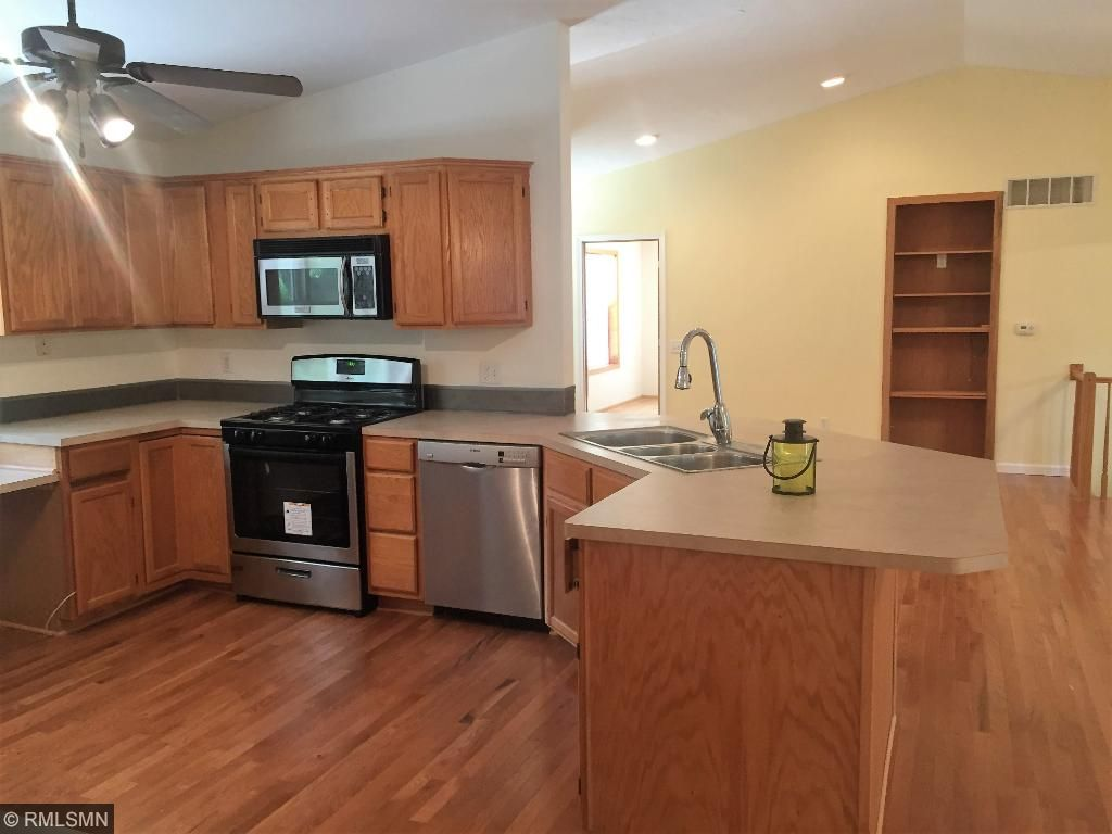 Brand new stove (still has the sticker on), newer dishwasher & gorgeous new wood floors!