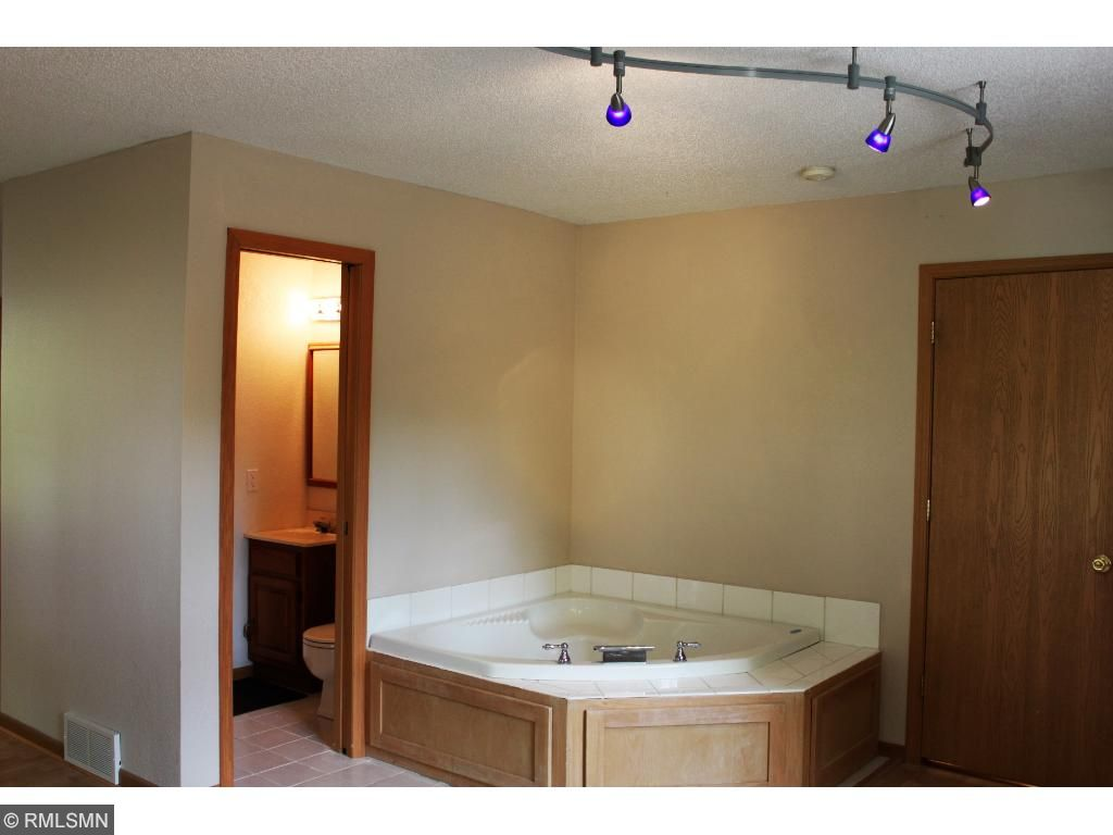 Private master with Jacuzzi tub & 2 walk-in closets!