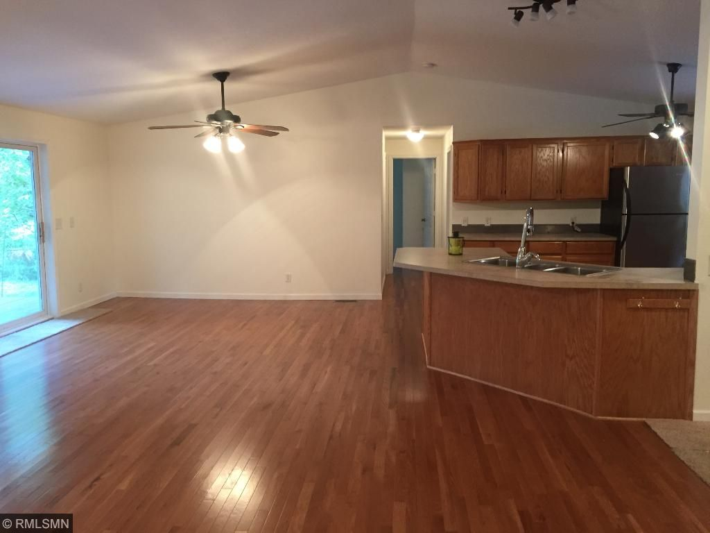 Look at these floors!! Note that the open dining/family room area has sliding door to access   deck & fenced yard. The hall leads to 2 other bedrooms & a large full bath with double vanity!