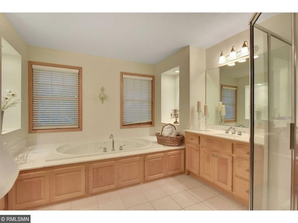 Luxurious five piece master bath with Jacuzzi tub, enormous glass door shower and double vanities!