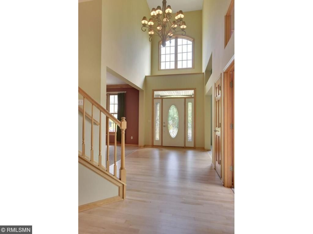 Walk into this open two story foyer, settled with hardwood floors and gleaming windows!
