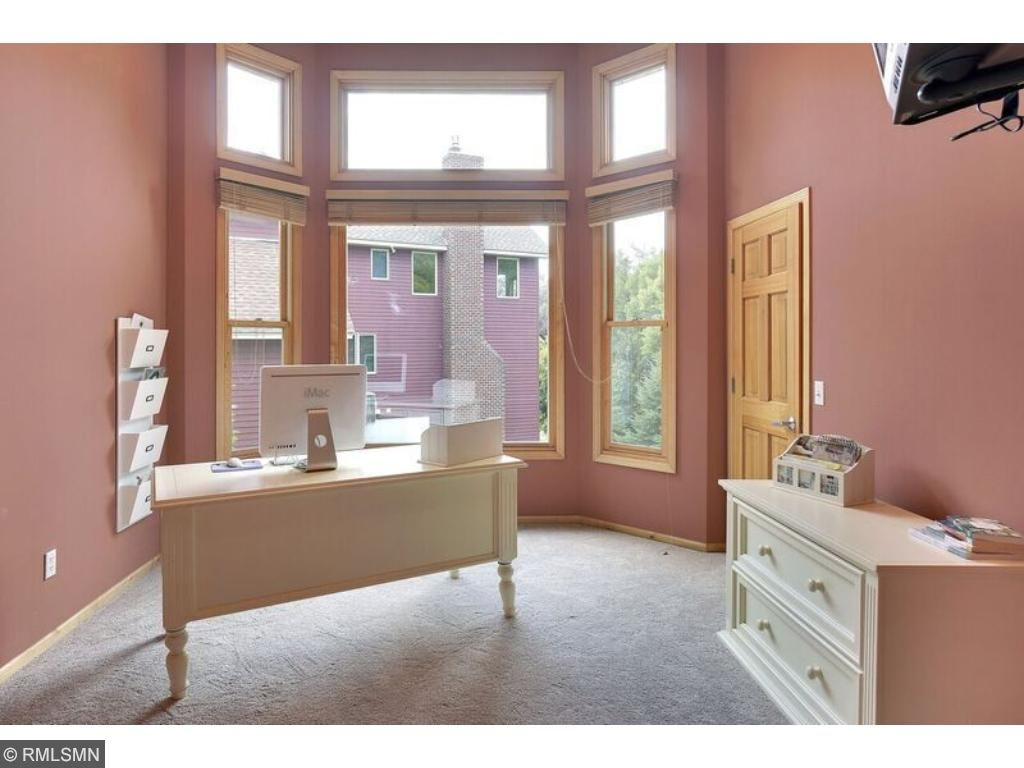 Thoughtfully designed main level office with bay windows and french doors.