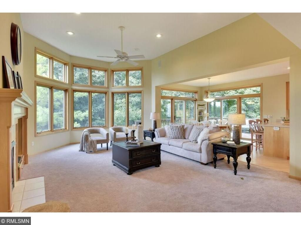 Huge main level great room with soaring ceilings, gas fireplace and built-in entertainment center. Look at all those gorgeous windows!