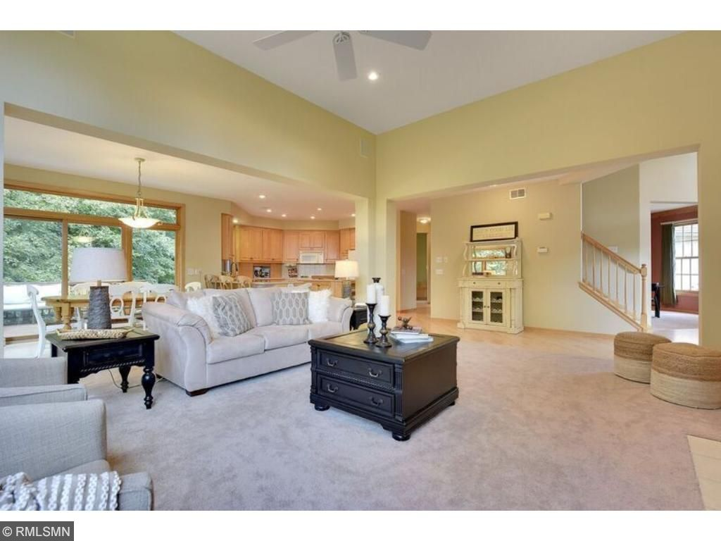 Open concept main level with seamless transition from living, dining and kitchen.