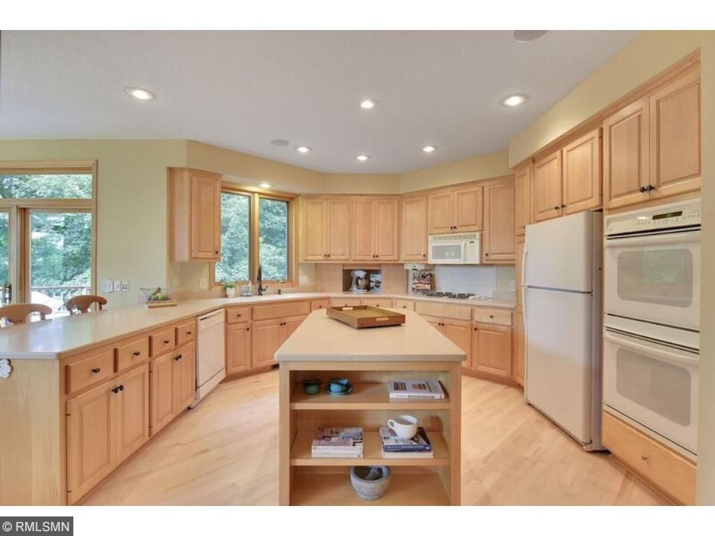Grand light kitchen with center island and breakfast bar, perfect for prep or serving!