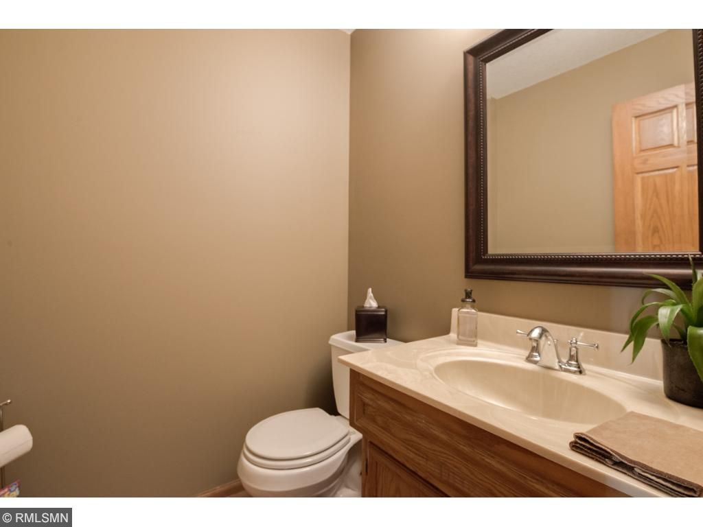 Your guests will appreciate this main floor powder room with trendy picture-frame mirror.