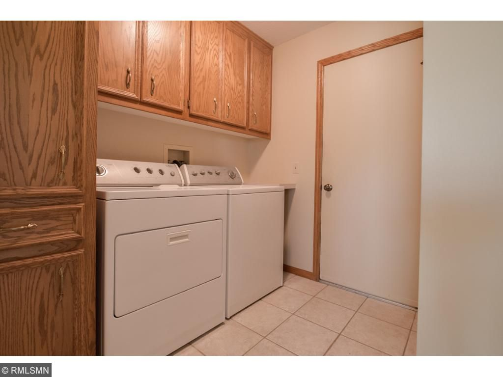 Tons of great cabinet and storage space in the laundry/mud room coming in from the 3-car garage.