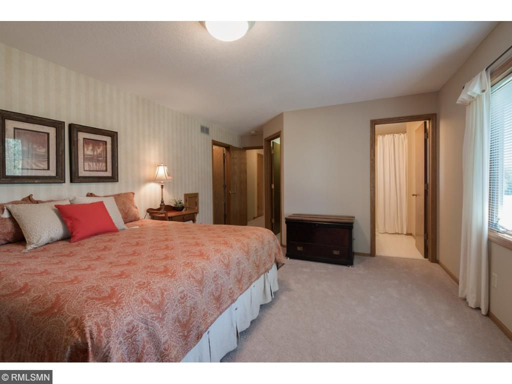 This huge, private owners' suite features his and hers walk-in closets and a private 3/4 bath.