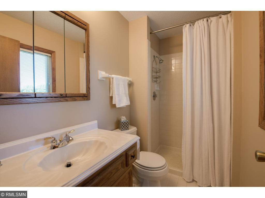 Private 3/4 bath with ceramic tile shower surround and cultured marble sink.