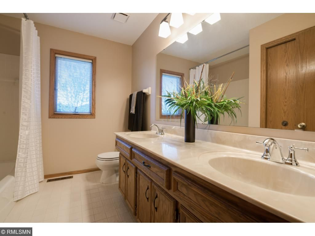 The other bedrooms share a very large full bath with dual sink vanity, updated fixtures and lighting.
