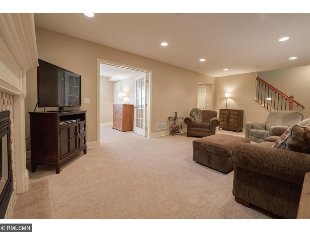 Beautiful glass French doors off the family room lead to another large lower level bedroom.