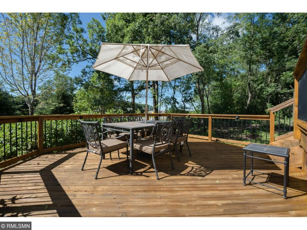 From the two-tiered deck you'll enjoy all the large trees and the great space for grilling and entertaining.