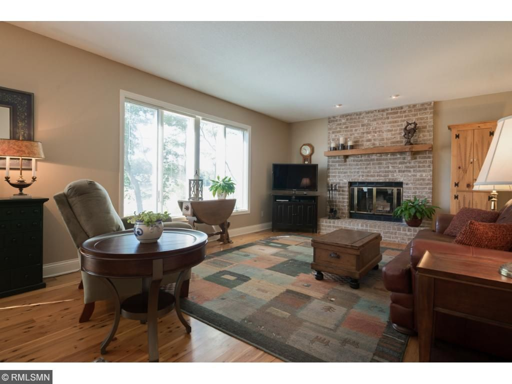 You'll love this main floor family room that shows off more cypress flooring and a wood-burning fireplace that features floor-to-ceiling brick and huge windows overlooking a beautiful backyard.