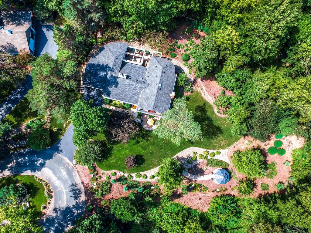 Aerial view of one acre lot. Amazing outdoor features.