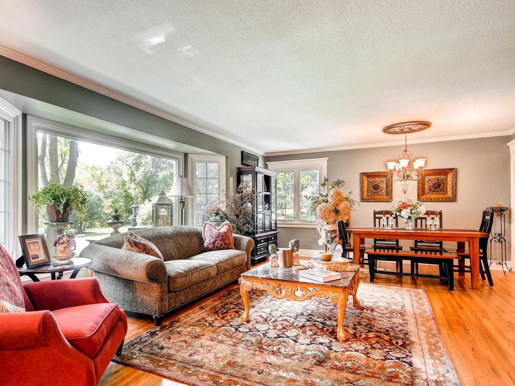 The sun drenched living room is spacious and perfect for any kind of gathering. The original hardwood floors are in pristine condition.  Enjoy the warmth of a fire in the gas burning fireplace.