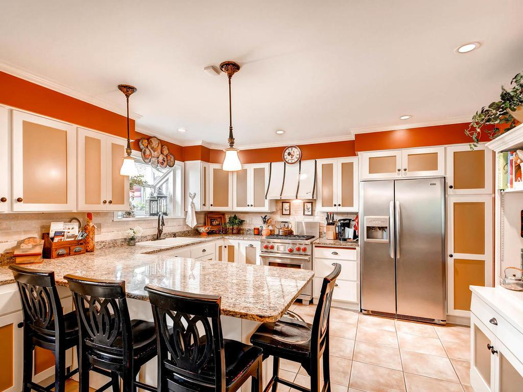 Gleaming granite, updated cabinets, and upper end appliances make this kitchen a chef's dream!