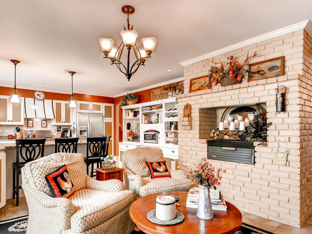 This cozy room is currently being used as a hearth room for reading and television.  It could easily be used as an informal dining room.