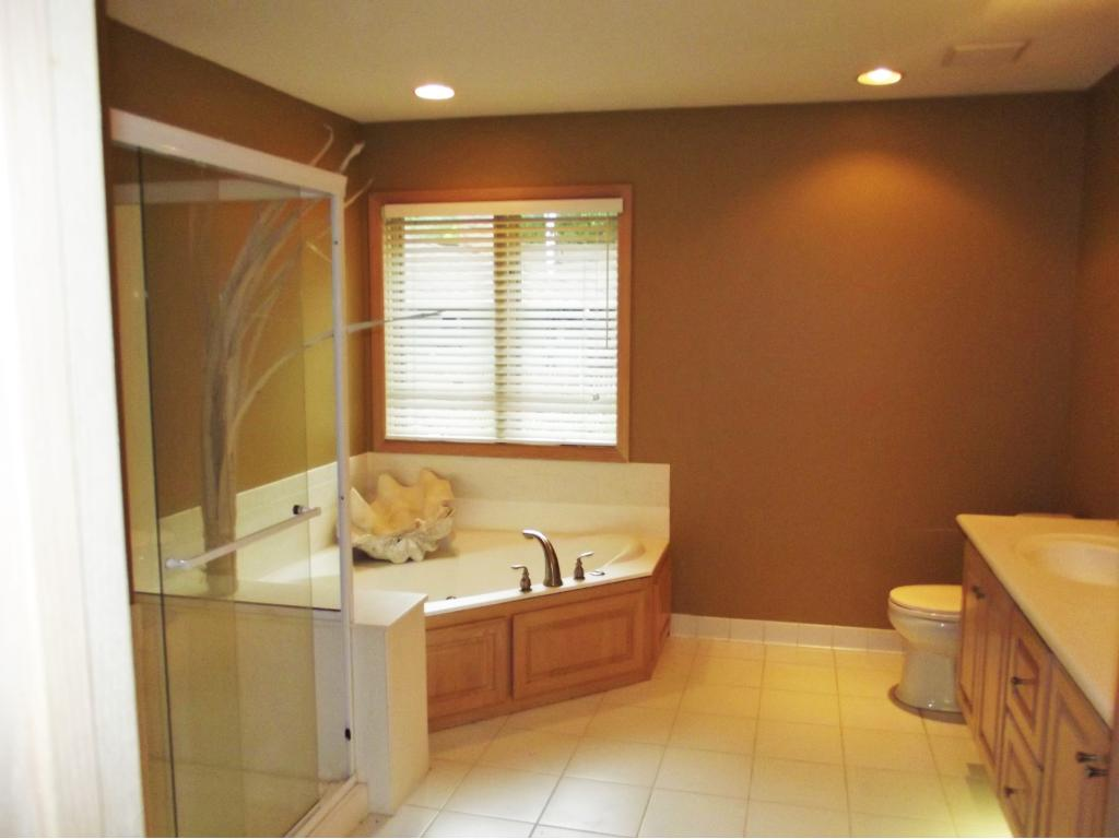 Private master bath has separate tub and shower. Large walk in closet and built in storage make this a wonderful suite.